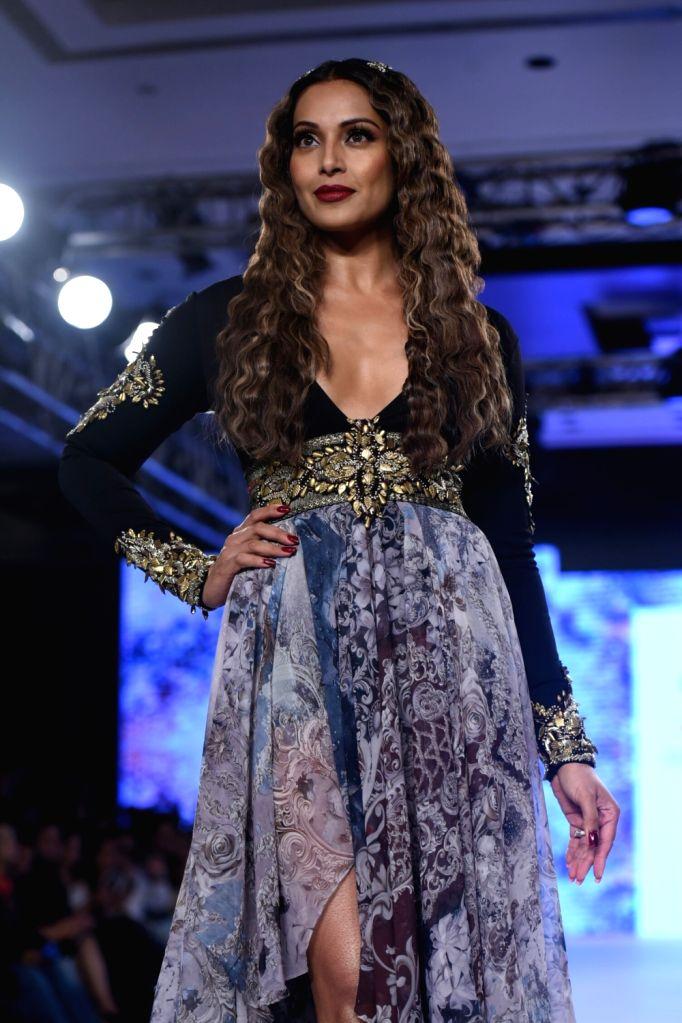 "Actress Bipasha Basu displays the creation of fashion designer Rocky S during the ""Bombay Times Fashion Week"" 2017 in Mumbai. - Bipasha Basu"
