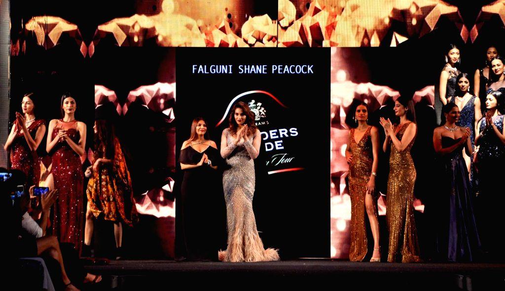 Actress Bipasha Basu walks the ramp during Blenders Pride Fashion Tour 2016 in Kolkata on Nov 26, 2016. - Bipasha Basu