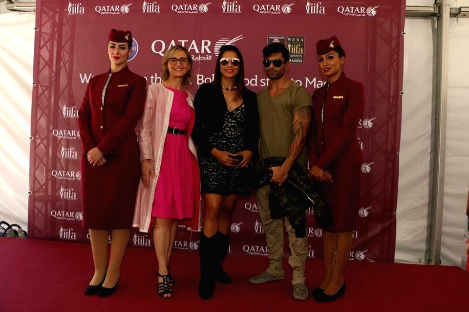 Actress Bipasha Basu with husband Karan Singh Grover at Adolfo Suarez Madrid-Barajas Airport to attend the International Indian Film Academy (IIFA) Awards in Madrid on June 22, 2016. - Bipasha Basu and Karan Singh Grover
