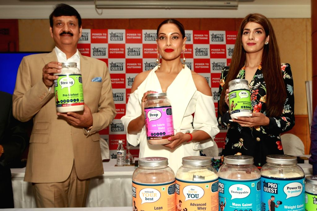 Actress Bipasha Basu with Paras Dairy MD Rajendra Singh during a promotional programme in New Delhi on July 2, 2017. - Bipasha Basu and Rajendra Singh