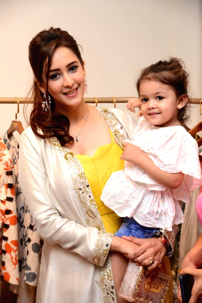 Actress Chahat Khanna with her daughter at the launch of fashion designer Pallavi Goyal's new store in Mumbai, on May 5 , 2019. - Chahat Khanna