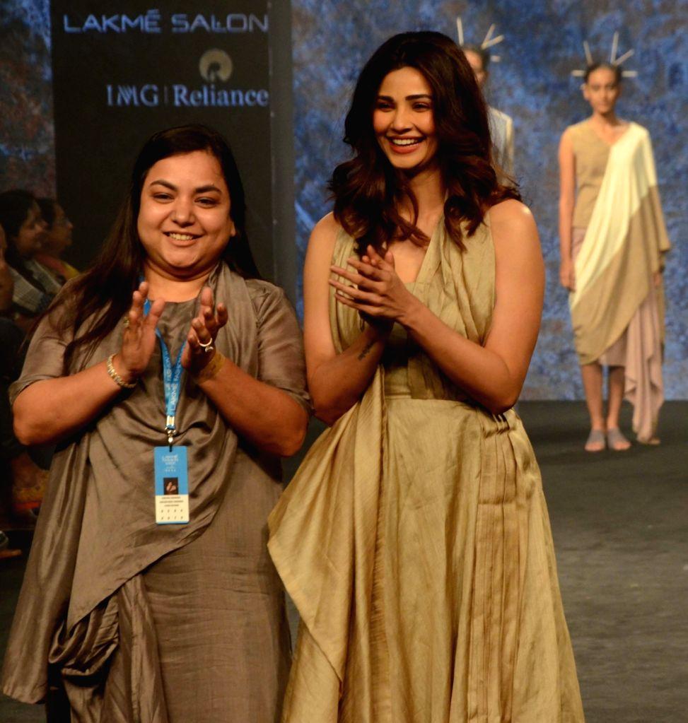 Actress Daisy Shah along with fashion designer Kanchan More Sabharwal during Lakme Fashion Week (LFW) Summer/Resort 2019 in Mumbai on Feb. 2, 2019. - Daisy Shah and Anjali Verma