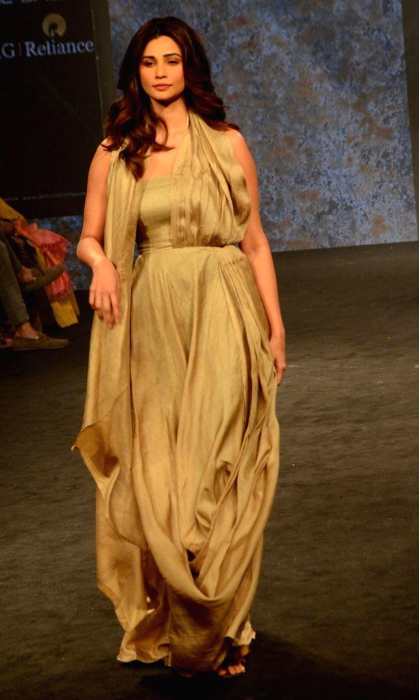 Actress Daisy Shah showcases fashion designer Kanchan More Sabharwal's creation during Lakme Fashion Week (LFW) Summer/Resort 2019 in Mumbai on Feb. 2, 2019. - Daisy Shah and Anjali Verma