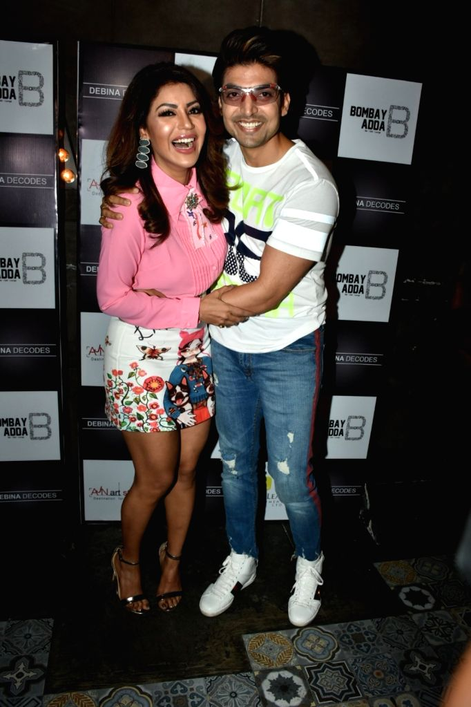 Actress Debina Bonnerjee with her husband Gurmeet Choudhary at the launch of her YouTube channel in Mumbai on April 6, 2018. - Debina Bonnerjee and Gurmeet Choudhary