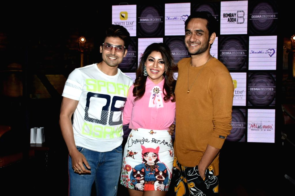 Actress Debina Bonnerjee with her husband Gurmeet Choudhary and producer Vikas Gupta at the launch of her YouTube channel in Mumbai on April 6, 2018. - Debina Bonnerjee, Gurmeet Choudhary and Vikas Gupta