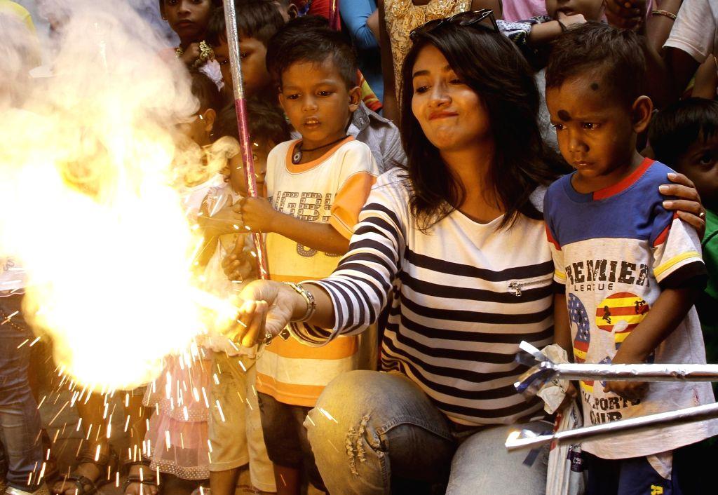 Actress Debolina Dutta celebrates Diwali with children in Kolkata on Oct 27, 2016. - Debolina Dutta