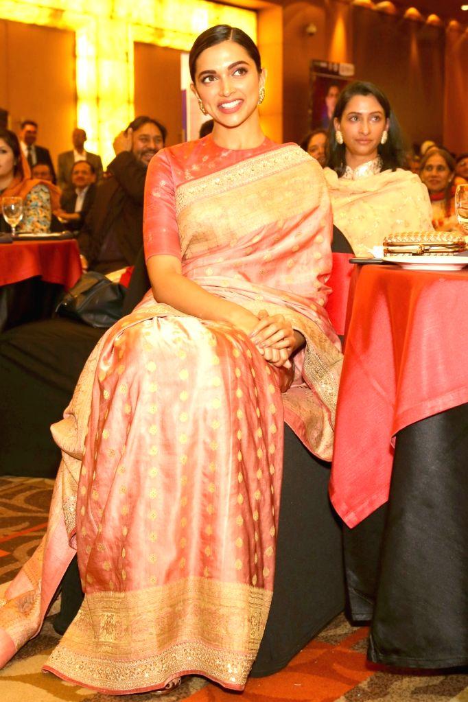 Actress Deepika Padukone looks on as her father, veteran badminton player Prakash Padukone receives the Lifetime Achievement Award from Vice President M. Venkaiah Naidu in New  Delhi on ... - Deepika Padukone, M. Venkaiah Naidu and Prakash Padukone
