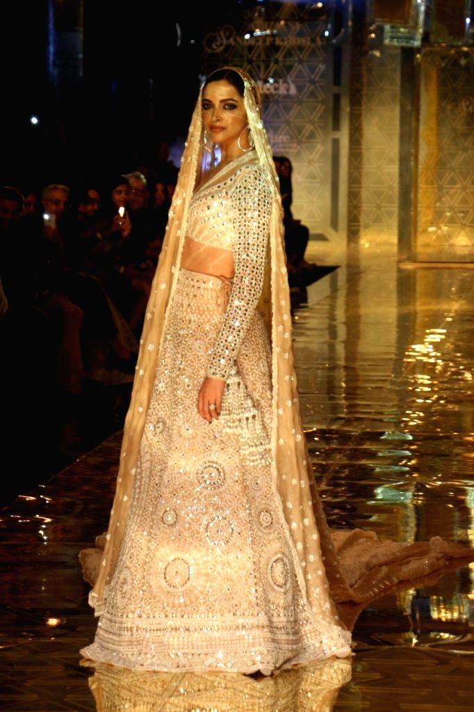 Actress Deepika Padukone showcases a creation of fashion designer Abu Jani-Sandeep Khosla during a fashion show in Mumbai, on Sep 5, 2019. - Deepika Padukone