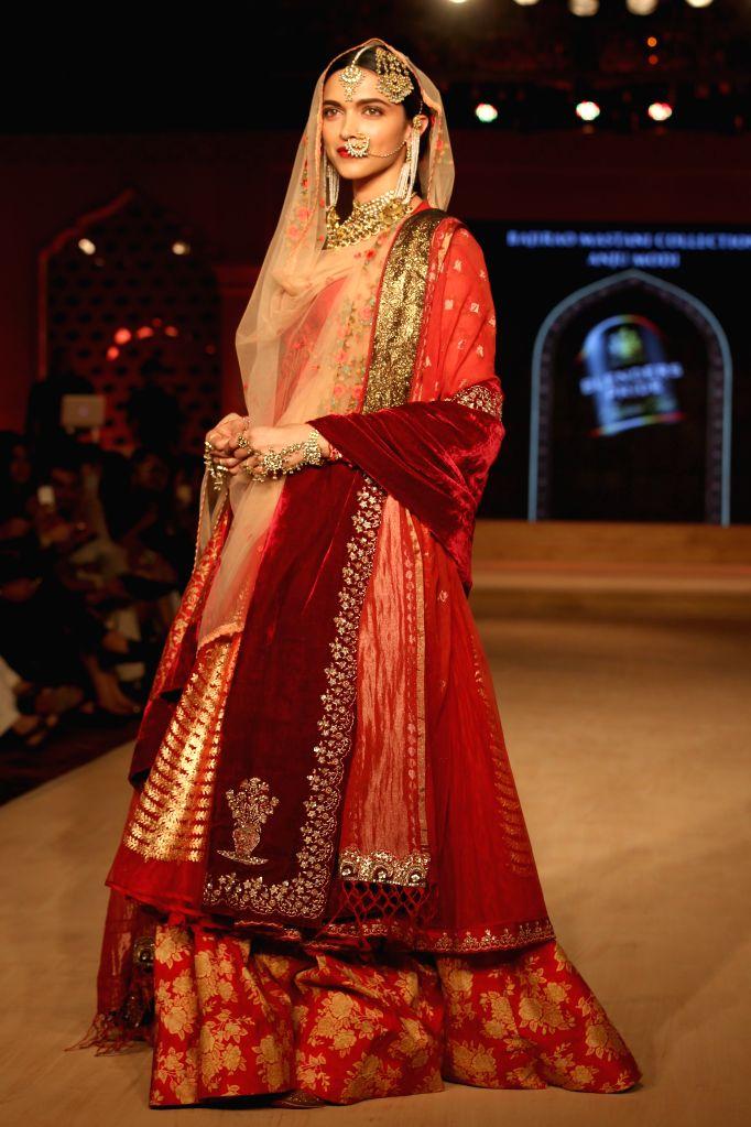 Actress Deepika Padukone walked the ramp for Designer Anju Modi at Blenders Pride Fashion Tour 2015, associated with Bajirao Mastani, in Gurgaon, on ,Oct 17,2015. - Deepika Padukone and Anju Modi