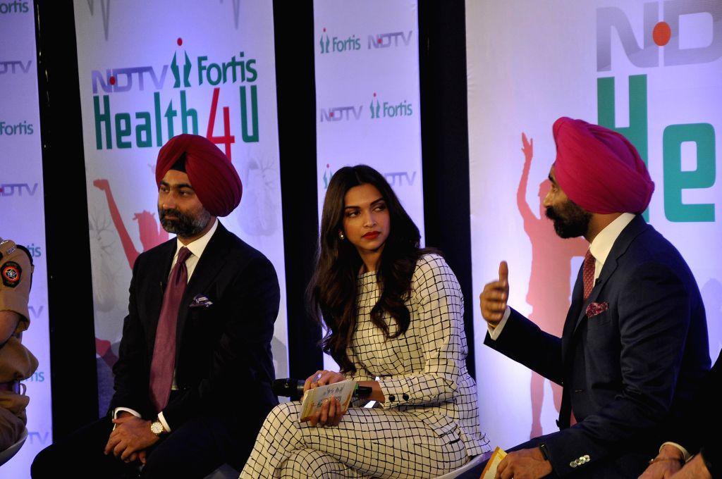 Actress Deepika Padukone with Malvinder Mohan Singh, Executive Chairman, Fortis Healthcare, and Shivinder Mohan Singh, Executive Vice-Chairman, Fortis Healthcare at the launch of `NDTV Fortis ... - Deepika Padukone, Malvinder Mohan Singh and Shivinder Mohan Singh