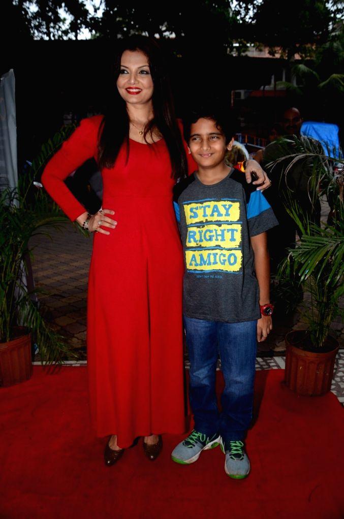 Actress Deepshikha Nagpal and her son Vivaan Upendra during the 8th Golden Camera Film and Television Awards 2016 in Mumbai on July 9, 2016. - Deepshikha Nagpal