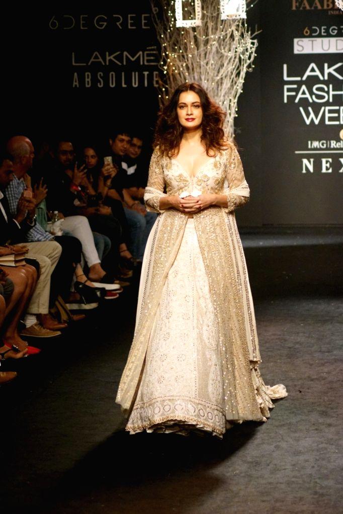 Actress Dia Mirza display the creation of fashion designer Faabiiana during the Lakme Fashion Week Winter/Festive 2017 in Mumbai on Aug 20, 2017. - Dia Mirza