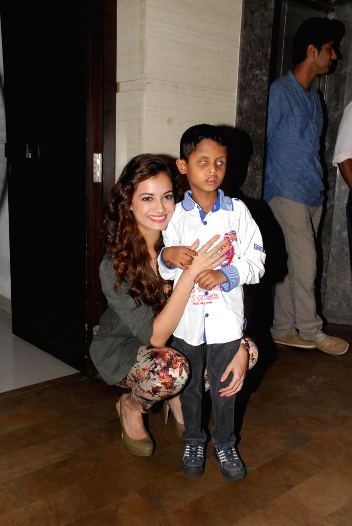 Actress Dia Mirza poses with a young visually impaired boy  during the unveiling of  ``B for Braille`` a musical short film by White Print that aims at promoting Braille literacy in Mumbai on 25th ...
