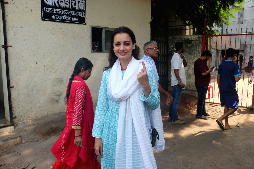 Actress Dia Mirza shows her inked finger after casting her vote for the fourth phase of 2019 Lok Sabha elections, in Mumbai on April 29, 2019. - Dia Mirza