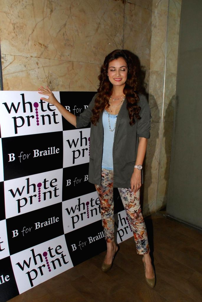 Actress Dia Mirza speaks to the media during the unveiling of  ``B for Braille`` a musical short film by White Print that aims at promoting Braille literacy in Mumbai on 25th August 2014