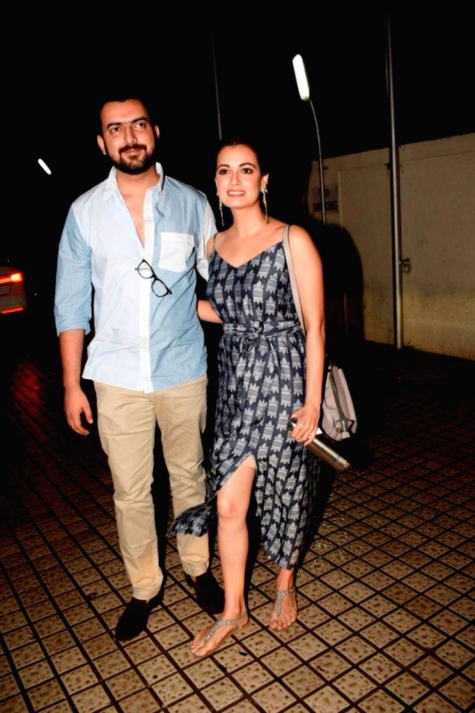 Actress Dia Mirza with her husband Sahil Sangha seen at a cinema theatre in Juhu, Mumbai on July 13, 2018. - Dia Mirza