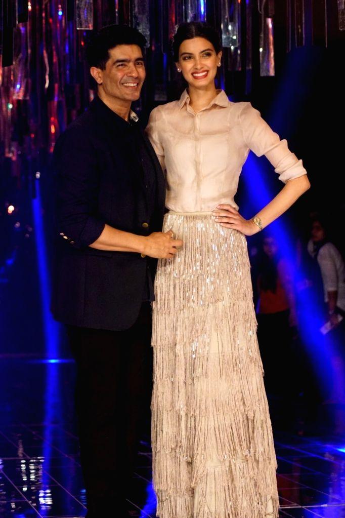 Actress Diana Penty and Fashion Designer Manish Malhotra during the Lakme Fashion Week Winter/Festive 2017 in Mumbai on Aug 20, 2017. - Diana Penty and Designer Manish Malhotra