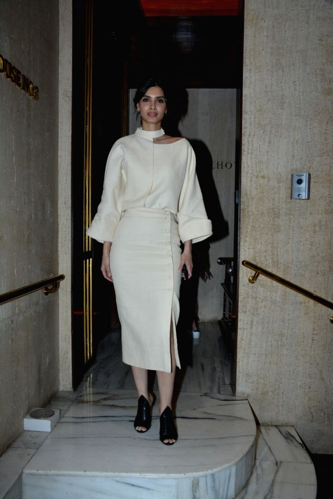 Actress Diana Penty at a house party hosted by fashion designer Manish Malhotra in Mumbai, on March 13, 2019. - Diana Penty and Manish Malhotra