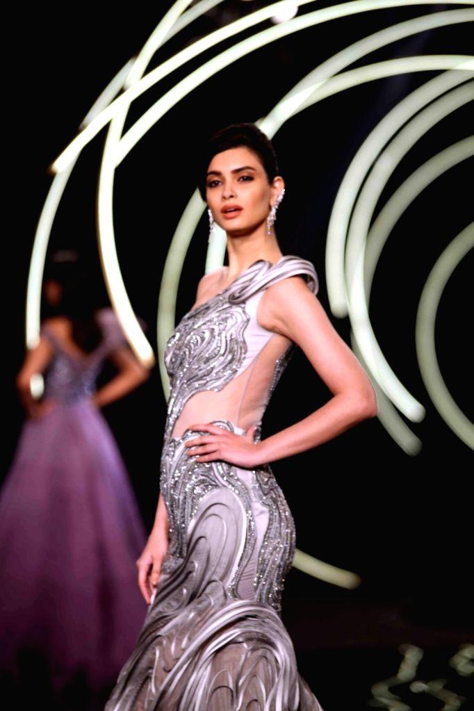 Actress Diana Penty walks the ramp for fashion designer Gaurav Gupta at the India Couture Week 2019 in New Delhi, on July 27, 2019. - Diana Penty and Gaurav Gupta