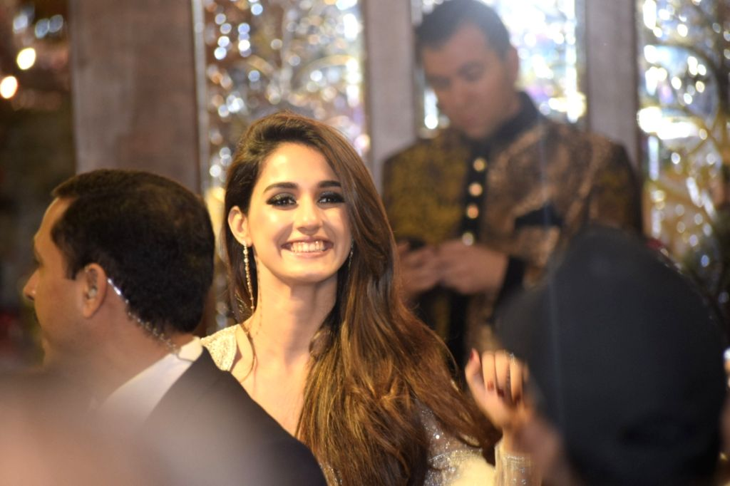 Actress Disha Patani at the wedding ceremony of industrialist Mukesh Ambani's daughter Isha Ambani and Anand Piramal at Antilia in Mumbai on Dec 12, 2018. - Disha Patani, Mukesh Ambani and Isha Ambani