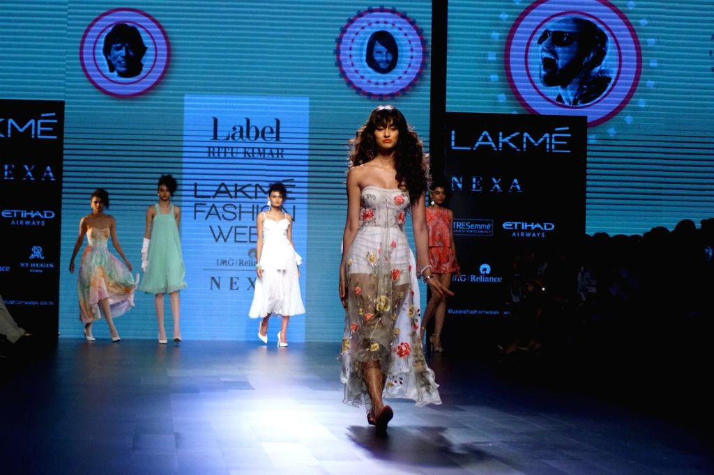 Actress Disha Patani displays the creation of fashion designer Ritu Kumar during the Lakme Fashion Week Wintwer 2017 in Mumbai on Aug 16, 2017. - Disha Patani and Ritu Kumar