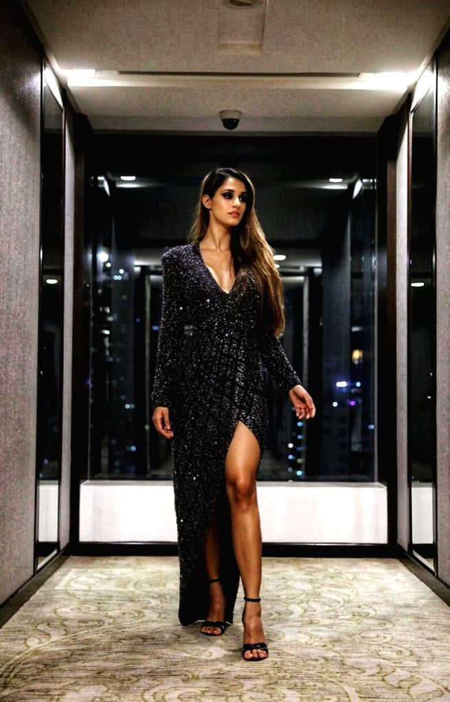 Actress Disha Patani slayed the Lakme Fashion Week Winter/Festive 2019 in a black sparkling outfit. - Disha Patani