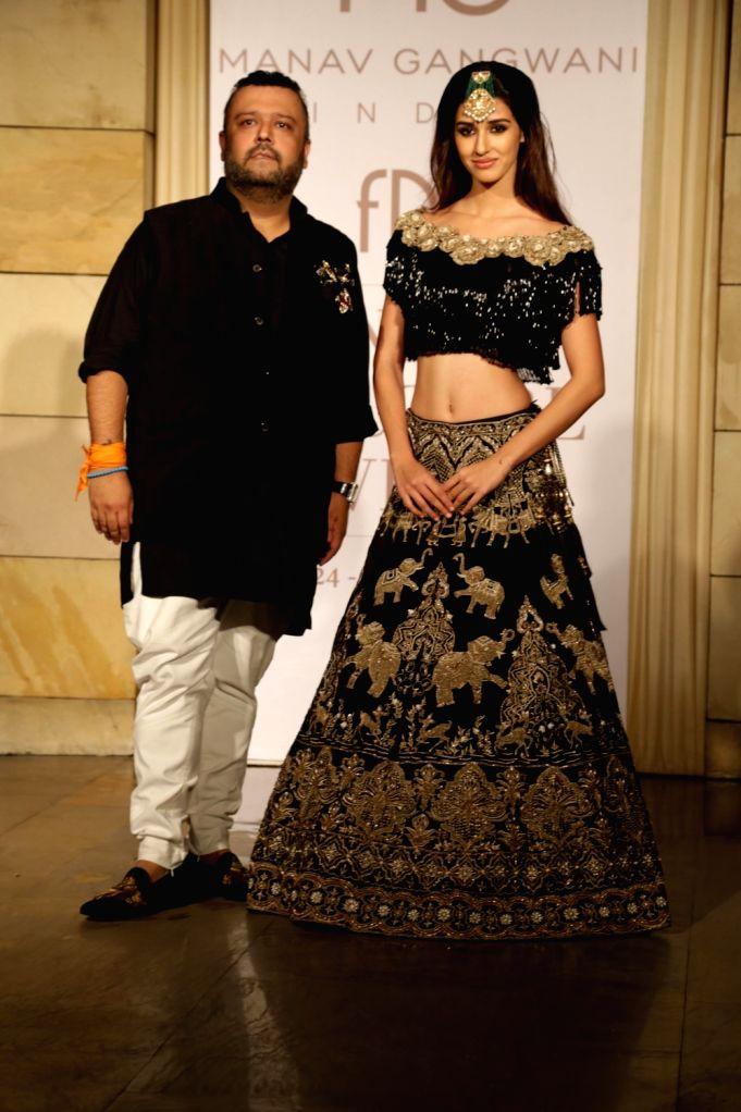Actress Disha Patani walks the ramp during designer Manav Gangwani's show at the India Couture Week 2017, in New Delhi, on July 26, 2017. - Disha Patani