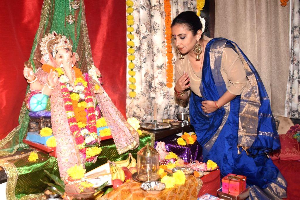 Actress Divya Dutta offers prayers to Lord Ganesha during Ganesh Chaturthi celebrations, in Mumbai on Sep 3, 2019. - Divya Dutta