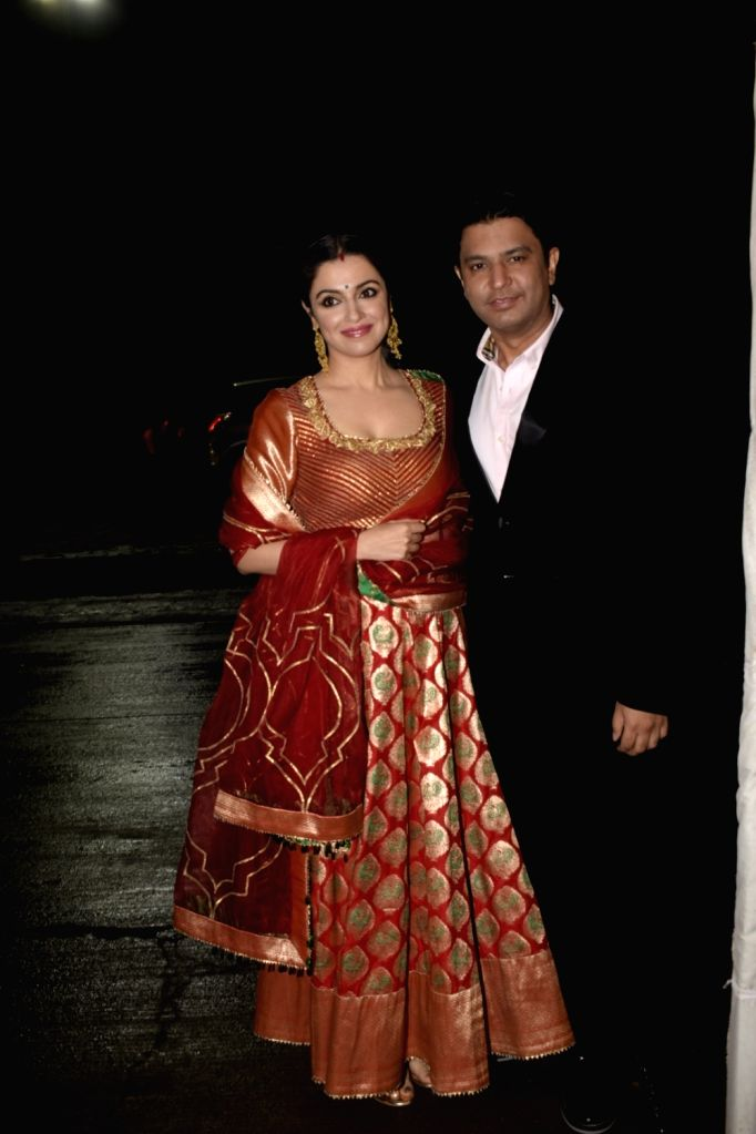 Actress Divya Khosla and film producer Bhushan Kumar arrive to attend NCP leader Praful Patel's daughter Poorna Patel's wedding reception, in Mumbai, on July 22, 2018. - Divya Khosla, Bhushan Kumar, Praful Patel and Poorna Patel