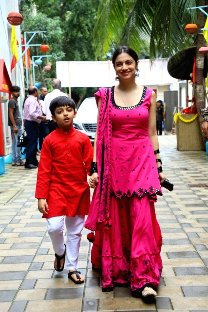 Actress Divya Khosla Kumar with her son Ruhaan Kumar during Ganesh idol immersion in New Delhi on Sep 12, 2019. - Divya Khosla Kumar and Ruhaan Kumar