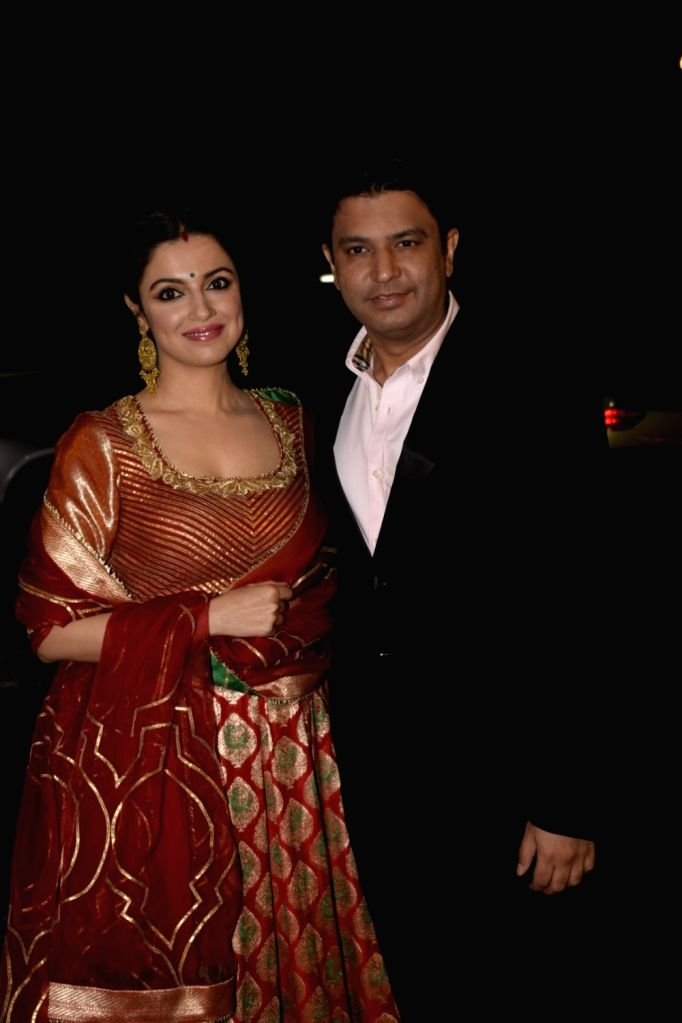 Actress Divya Khosla with film producer Bhushan Kumar arrive to attend NCP leader Praful Patel's daughter Poorna Patel's wedding reception, in Mumbai, on July 22, 2018. - Divya Khosla, Bhushan Kumar, Praful Patel and Poorna Patel