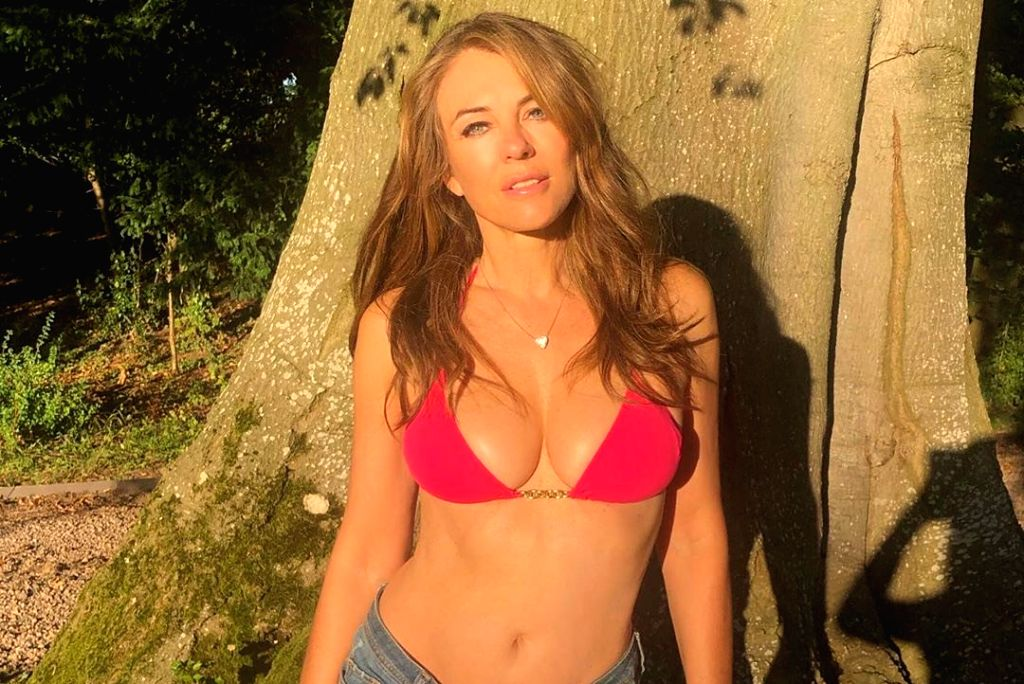 Actress Elizabeth Hurley, 54, flaunted her fabulous figure in a tiny red bikini and denim hotpants while promoting her swimwear range. The mother-of-one rocked the cleavage-baring, halterneck top and ... - Elizabeth Hurley