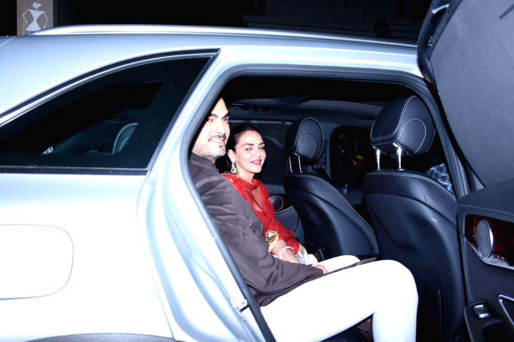 Actress Esha Deol and husband Sahil Takhtani at actor Amitabh Bachchan's Diwali party in Mumbai on Oct 27, 2019. - Esha Deol and Amitabh Bachchan