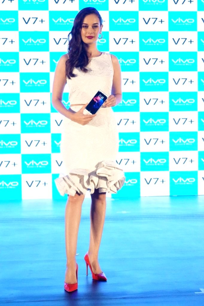 Actress Evelyn Sharma during the launch of Vivo V7+ smartphone in Mumbai on Sept 11, 2017. - Evelyn Sharma