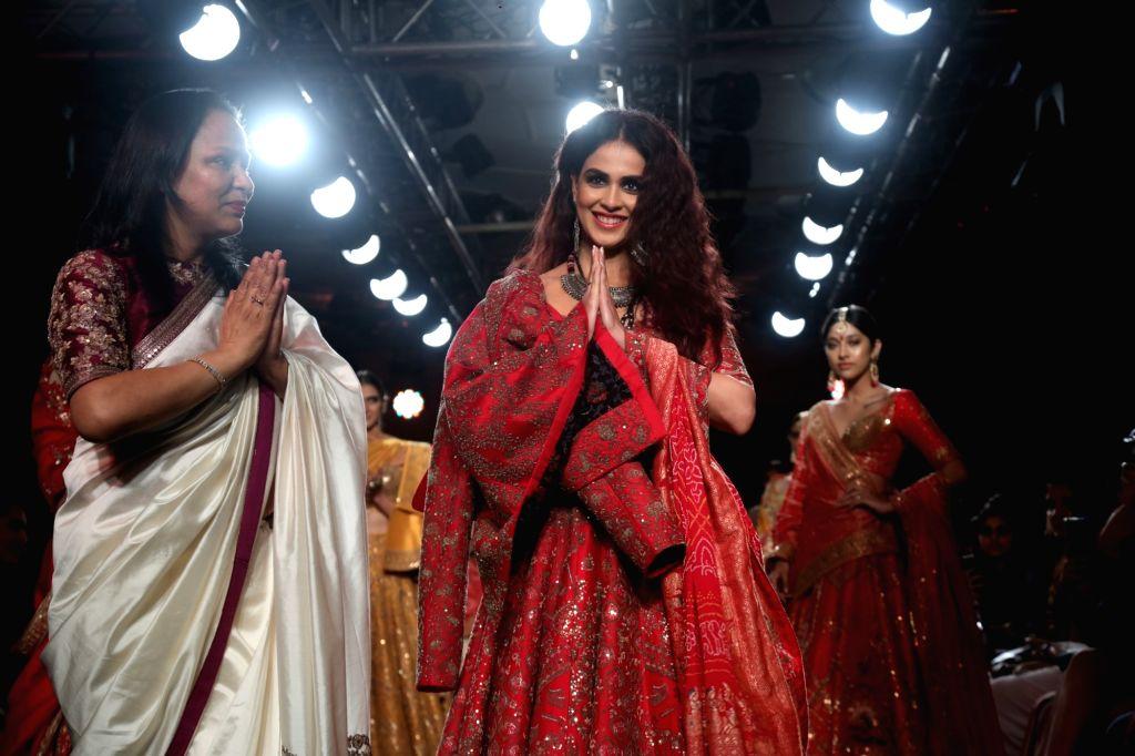 Actress Genelia Deshmukh walks the ramp for designer Saroj Jalan at the Lakme Fashion Week Winter/Festive 2019 in Mumbai on Aug 25, 2019. - Genelia Deshmukh