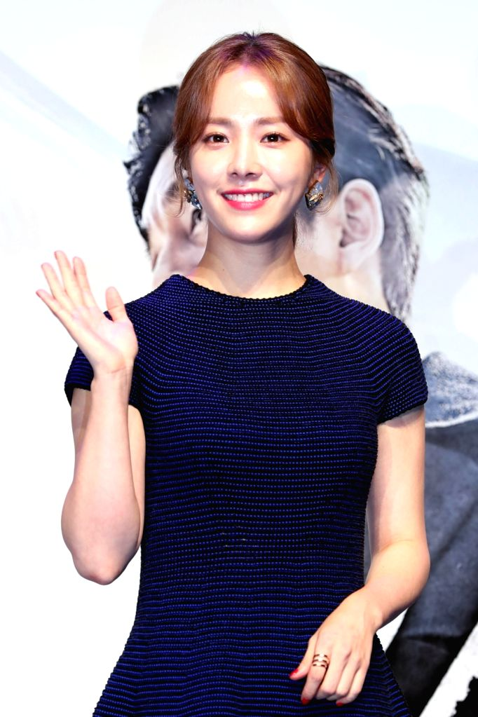 """Actress Han Ji-min, who stars in the new movie """"The Age of Shadows,"""" poses during a promotional programme at a Seoul theater on Aug. 4, 2016. - Han J"""