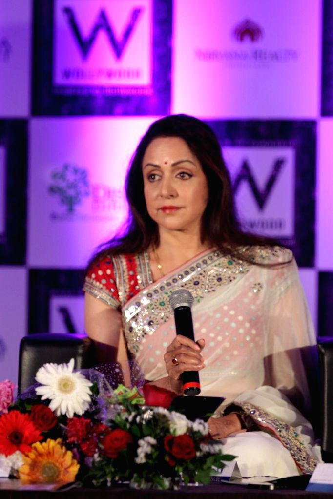 Actress Hema Malini arrives for the launch of Wollywood, an integrated township on the outskirts of Mumbai on Nov. 11, 2014.