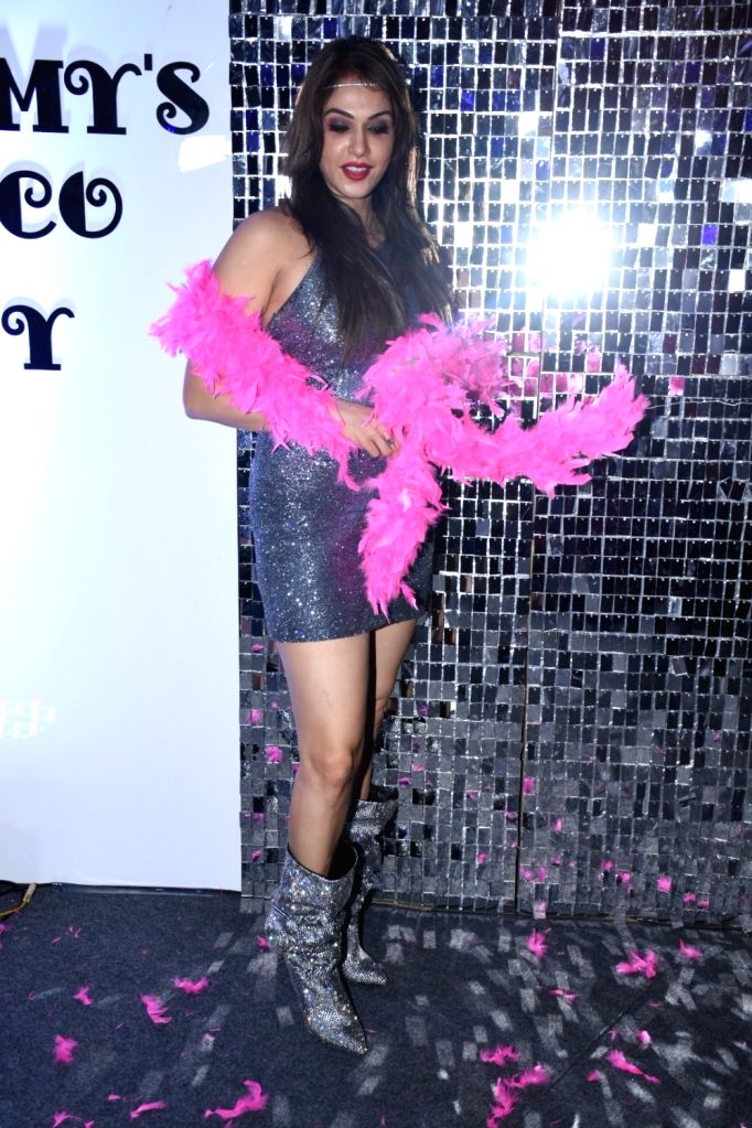 Actress Isha Koppikar during her wedding anniversary party, in Mumbai on Dec 6, 2019. - Isha Koppikar
