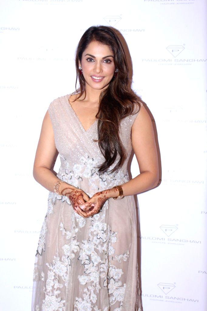 Actress Isha Koppikar during the launch of Jewellery Designer Paulomi Sanghavi's red carpet collection in Mumbai on Oct 9, 2017. - Isha Koppikar
