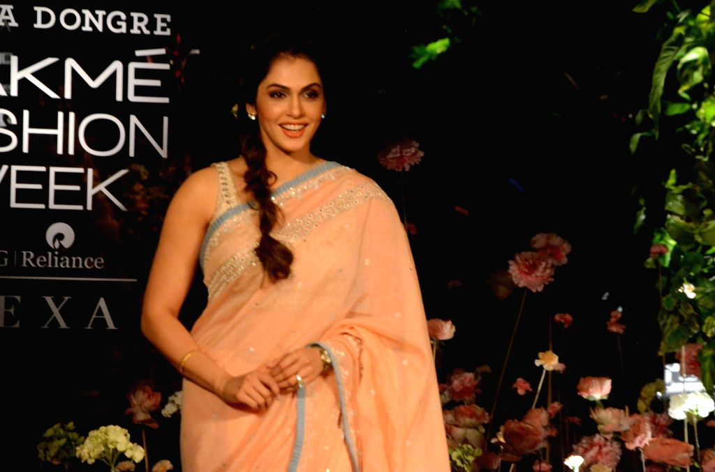 Actress Isha Koppikar showcases fashion designer Anita Dogre's creation on Day 2 of the Lakme Fashion Week (LFW) Summer/Resort 2019 in Mumbai, on Jan 31, 2019. - Isha Koppikar