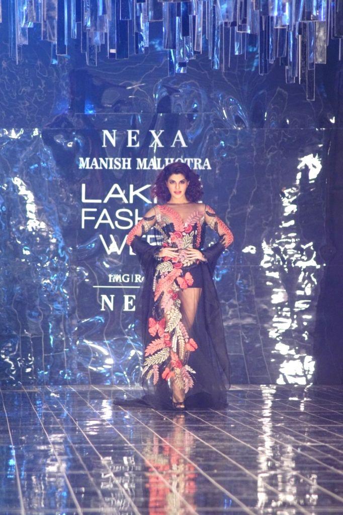 Actress Jacqueline Fernandez displays the creation of fashion designer Manish Malhotra during the Lakme Fashion Week Winter/Festive 2017 in Mumbai on Aug 20, 2017. - Jacqueline Fernandez and Manish Malhotra