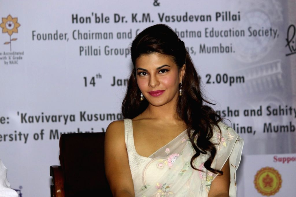 Actress Jacqueline Fernandez felicitated with Citizen Par Excellence award during the 13th International Commerce and Management conference organised by Mumbai University in Mumbai on Jan 14, ... - Jacqueline Fernandez