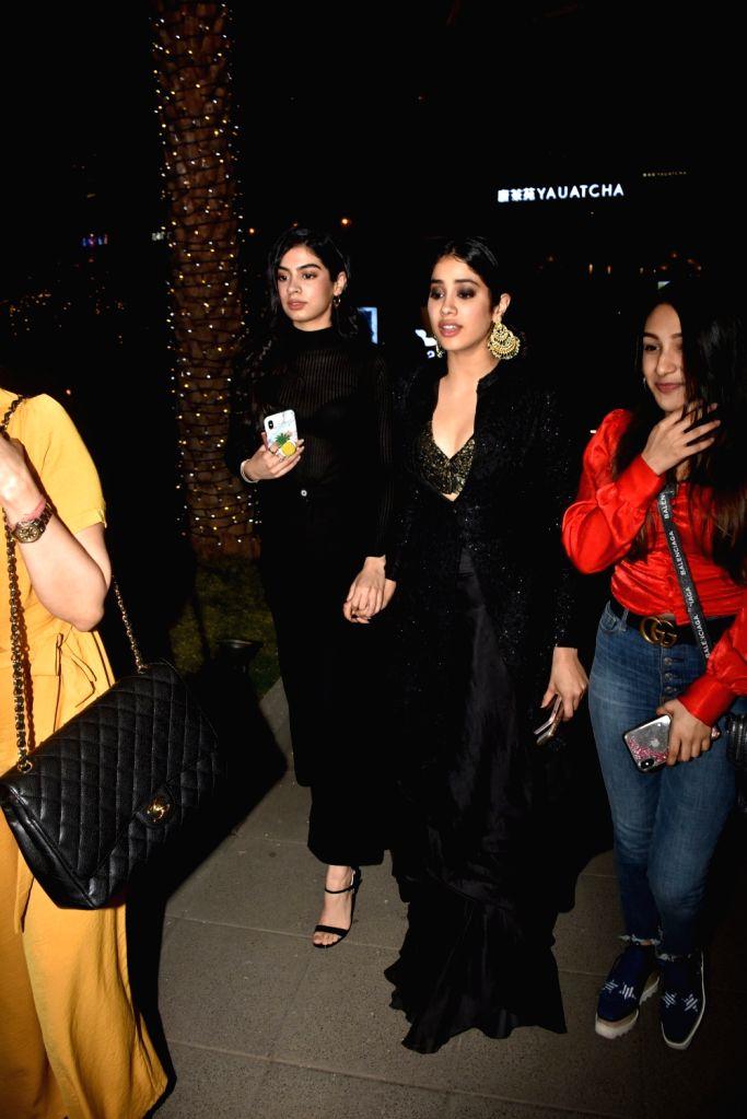 Actress Jahnvi Kapoor with her sister Khushi Kapoor, arrives at fashion designer Masaba Gupta's birthday bash in Mumbai's Bandra on Feb 2, 2019. - Jahnvi Kapoor, Khushi Kapoor and Masaba Gupta