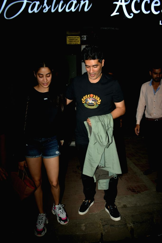 Actress Janhvi Kapoor and fashion designer Manish Malhotra seen at Mumbai's Bandra on July 25, 2018. - Janhvi Kapoor and Manish Malhotra