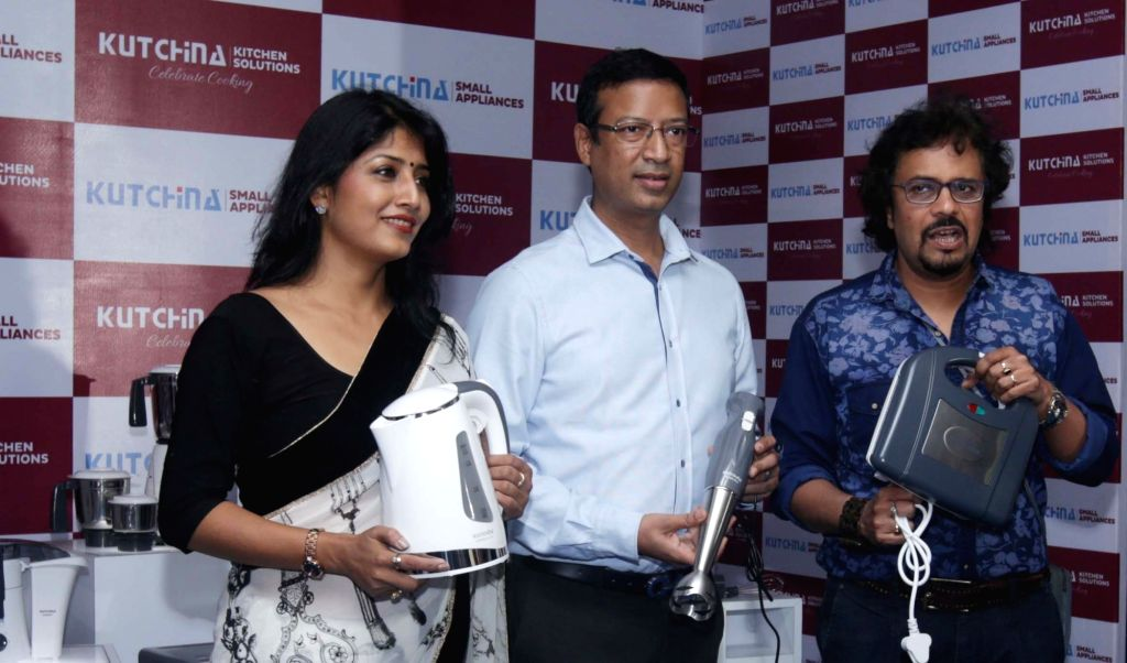 Actress Jaya Seal Ghosh, Bajoria Appliances Director Namit Bajoria and percussionist Bickram Ghosh during a promotional programme in Kolkata on June 24, 2016. - Jaya Seal Ghosh and Bickram Ghosh