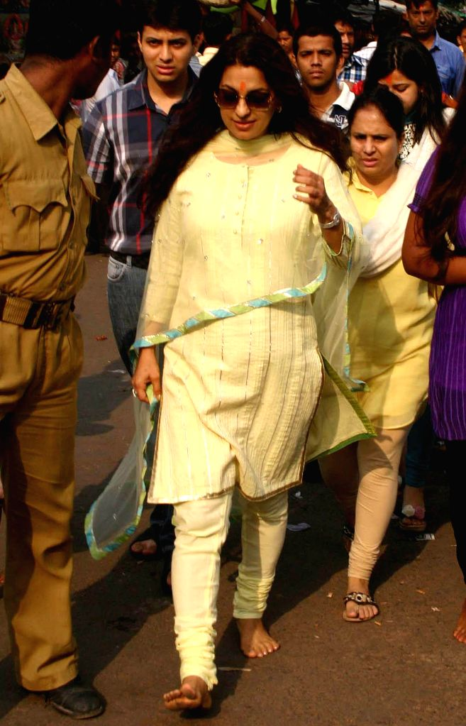 Actress Juhi Chawla arrives at Kalighat temple on `Poila Baisakh` in Kolkata on April 15, 2014. Poila Baisakh which is the first day of the Bengali calendar which is loosely tied with the Hindu Vedic