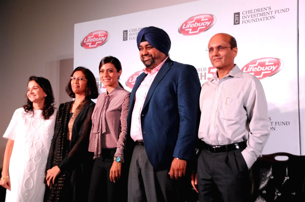 Actress Kajol and brand ambassador of Help a Child Reach 5 with Samir Singh, Executive Director, Hindustan Unilever during the launch of film Future Child, in Mumbai on Oct 29, 2015. - Samir Singh