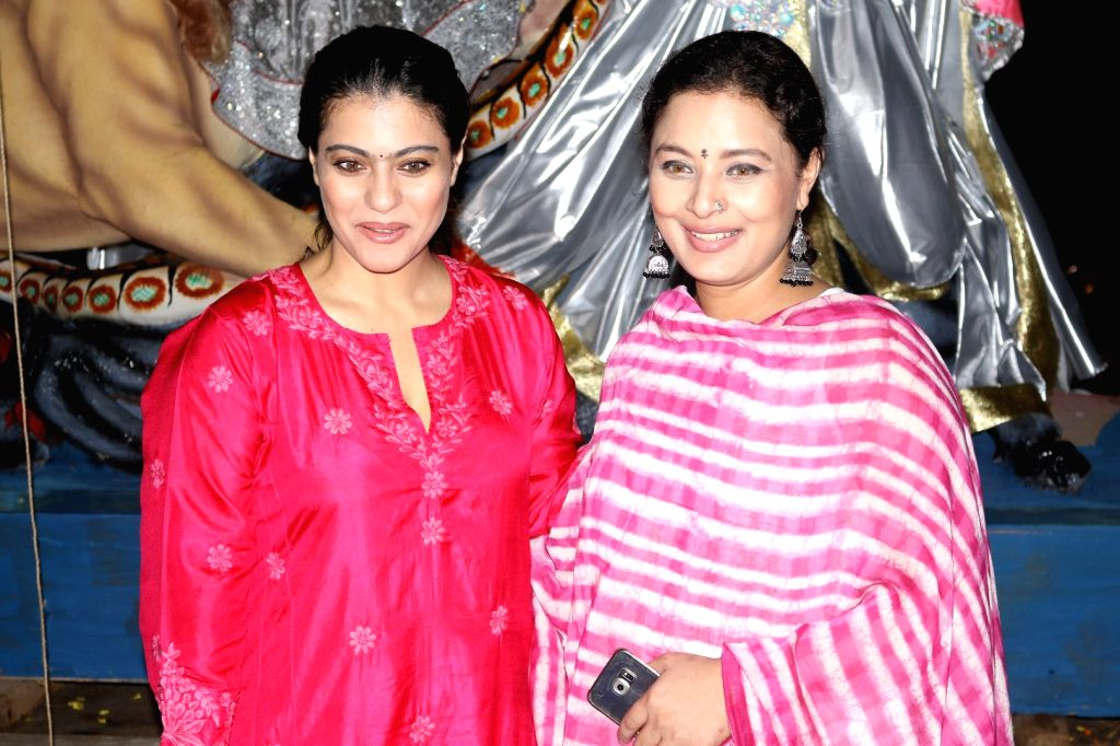 Actress Kajol and Sharbani Mukherjee during the welcoming of North Bombay Sarbojanin Durga Puja Samiti`s Goddess Durga idol, in Mumbai on Oct. 2, 2016. - Kajol and Sharbani Mukherjee