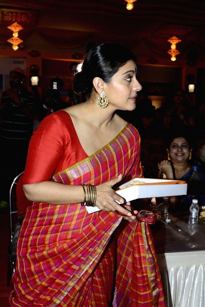 Actress Kajol during North Bombay Durga Puja celebrations in Mumbai on Oct. 8, 2016. - Kajol