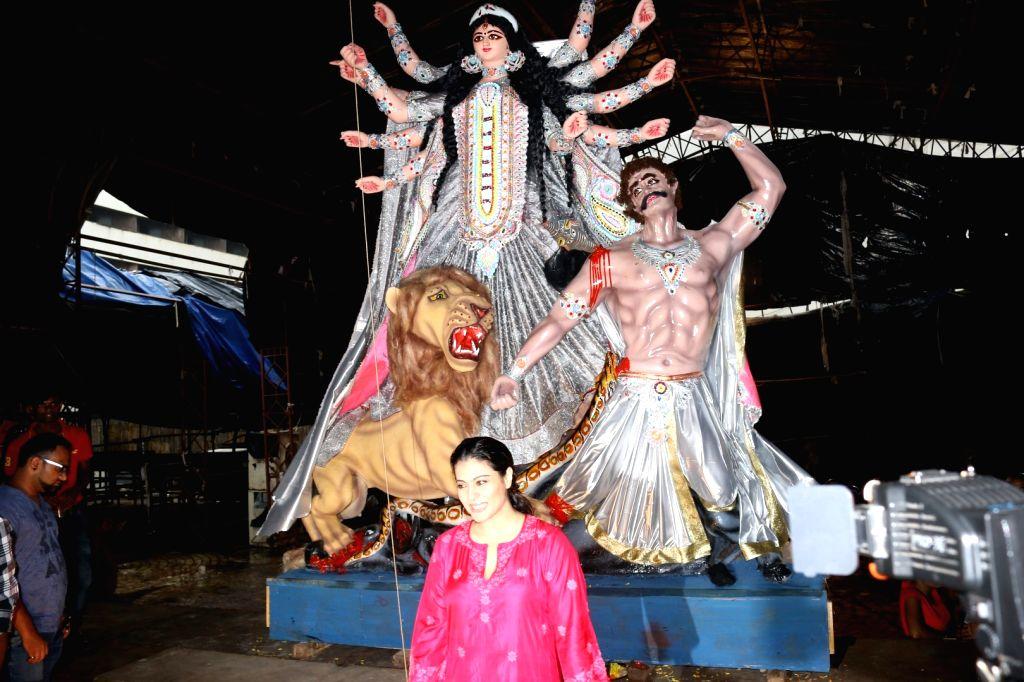 Actress Kajol during the welcoming of North Bombay Sarbojanin Durga Puja Samiti`s Goddess Durga idol, in Mumbai on Oct. 2, 2016. - Kajol